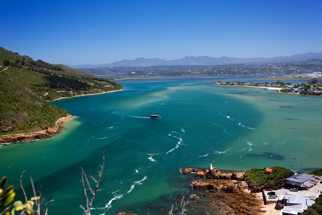 Knysna lagoon with boat in water